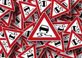 a number of danger signs (skidding) criss-cross