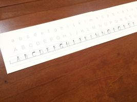 Letter peak strip with capitals