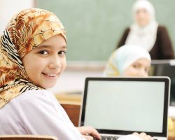 Girl with headscarf on a laptop
